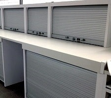 tambour shutters closed on cabinet doors