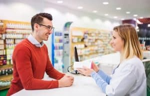 Client at a pharmacy counter receiving advice