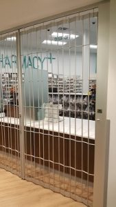 pharmacy utility grille closed on pharmacy store