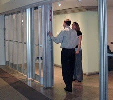 man showing woman wide folding prestige security door