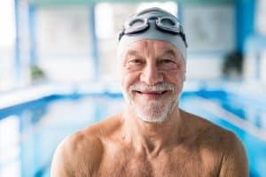 Smiling senior in a swimming pool